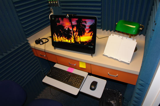 Headset, workstation, document stand and lamp, everything for a great recording session.