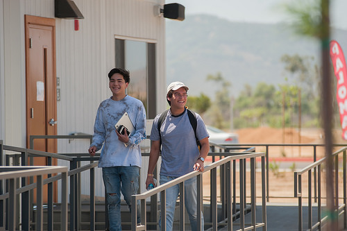 This image is of two students smiling on the first day of class