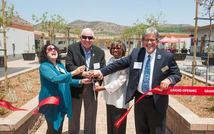 This image shows NEC Grand Opening ribbon cutting ceremony with President Blake and Governing Board members