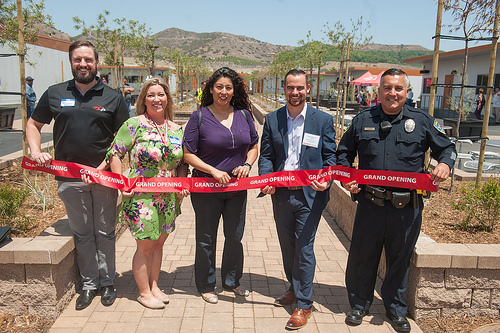 This image is of staff cutting the ribbon and includes Campus police, Assessment, Instruction, and Counseling