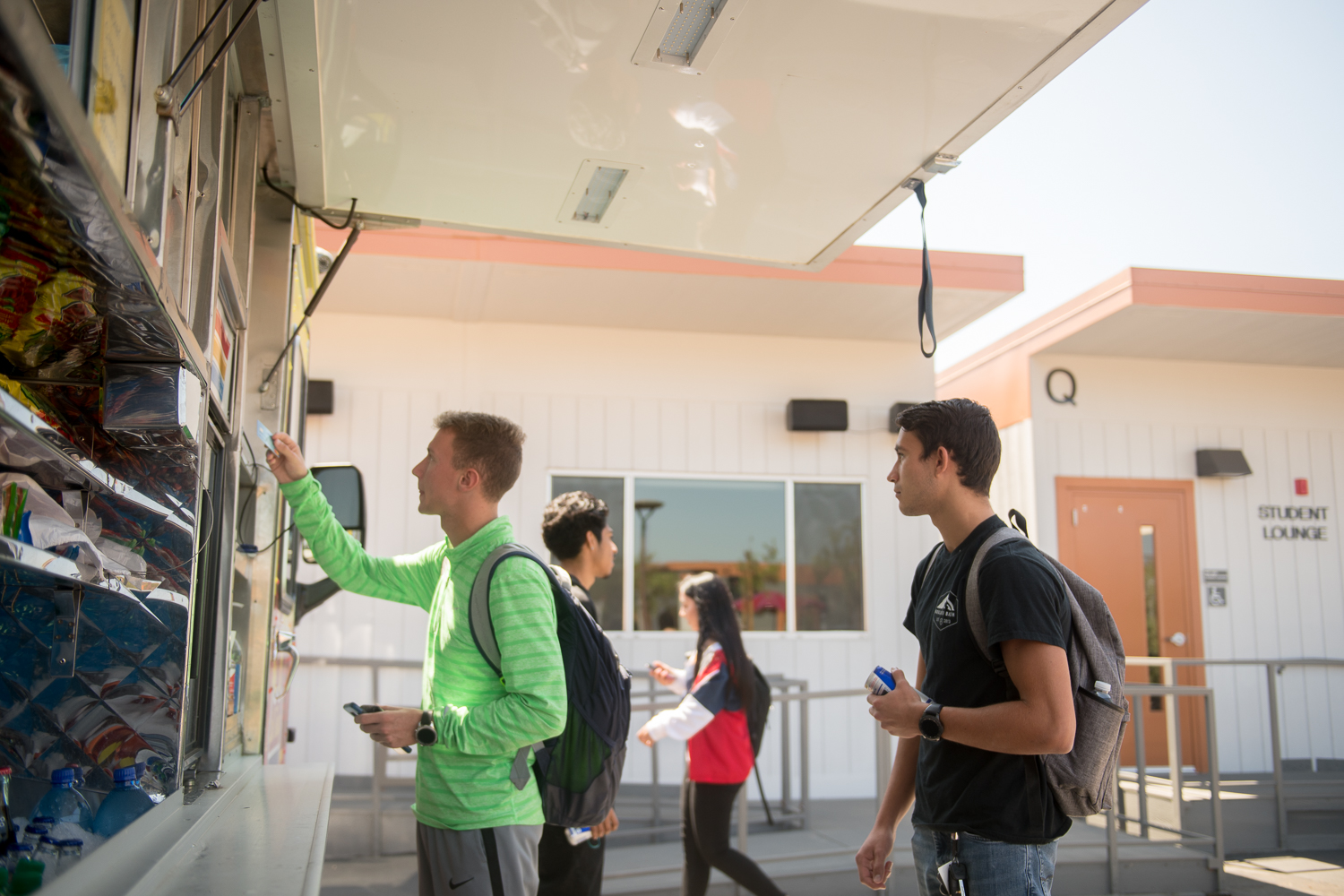 Students ordering lunch from a food truck
