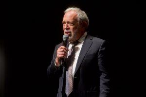 Robert Reich holding microphone
