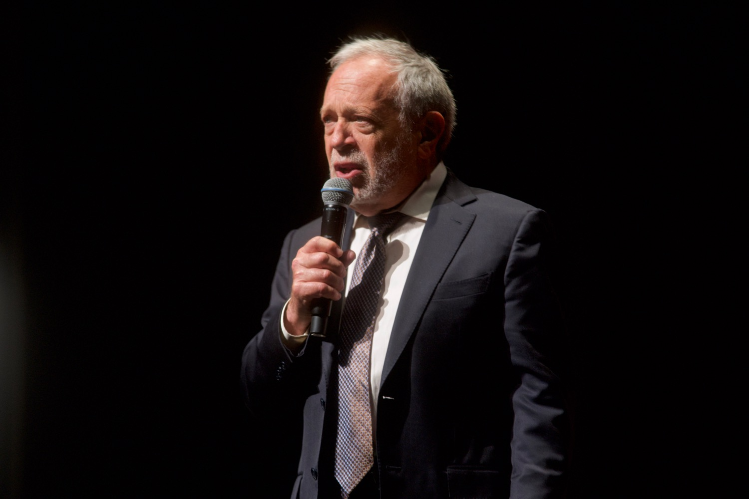 Robert Reich holding microphone