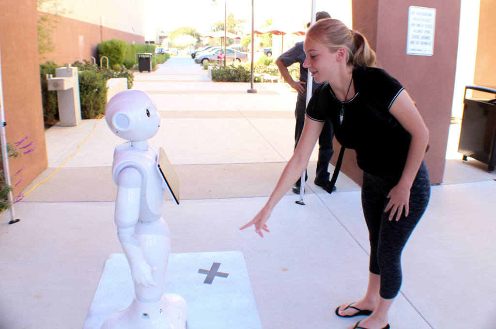 Palomar student Madison Boone interacts with Pepper on Oct. 16 at the Escondido campus. Claudia Whitman/ The Telescope