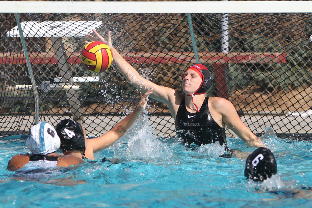 Palomar's Jordann Heimback defends the goal during the game against San Diego Miramar on Oct. 11 at Wallace Memorial Pool. Final score was Palomar 12 and San Diego 7. Julie Lykins / The Telescope