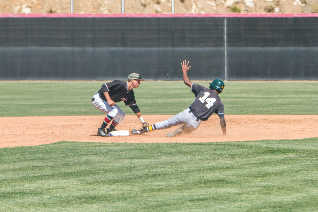 Palomar's Gabe Willes tags the runner out at second base who was thrown out by catcher Tristan King on a steal against Grossmont College on April 20. Pat Rindone / The Telescope