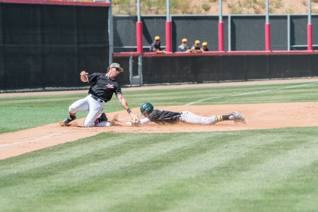 Palomar's Conor McKenna tags the runner out at third as the runner was trying to steal to get into scoring position on April 20 against Grossmont College. Pat Rindone / The Telescope