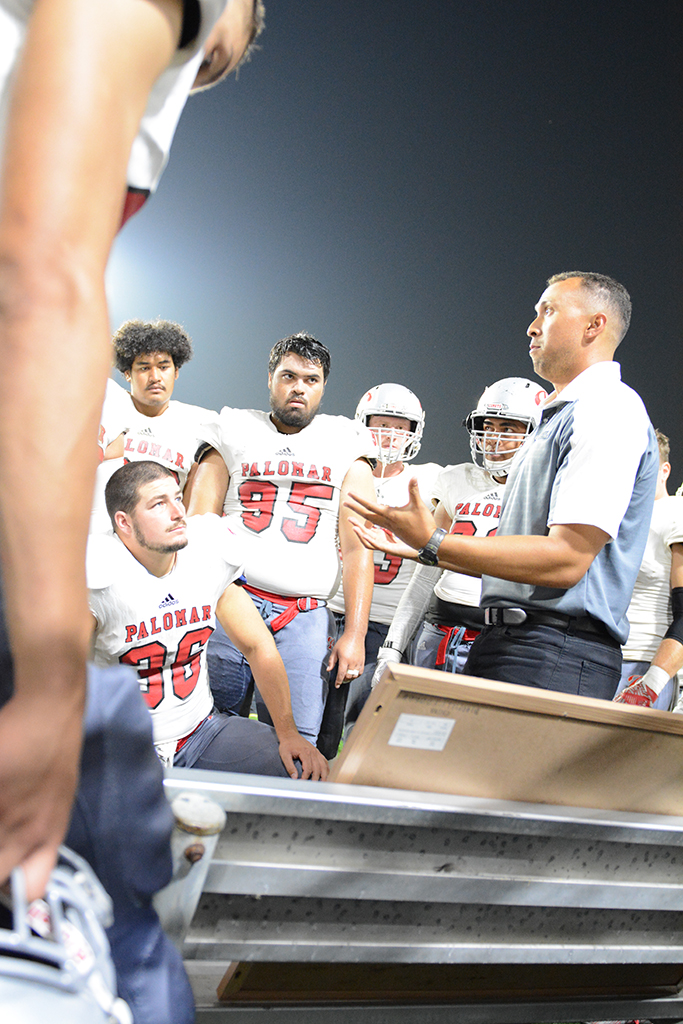 Palomar safeties coach Derrick McMahan rallies the defense on the sideline as the Comets attempted to come back from a first half deficit of 21-3 against Orange Coast. Palomar ran out of time, losing 28-20. Anabel Malacara/ The Telescope