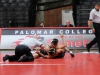 Palomar's Issac Guerrero works to pin Sam Valle during the opening bout of the Comets' match against the Santa Ana Dons on Nov. 8 in the Dome, Guerrero won by 11-3 major decision. Scott Engrav / The Telescope