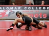 Palomar's Issac Guerrero tries to regain the advantage against Santa Ana's Sam Valle in the 125 lb weight class match Nov. 8 at the Dome. Guerrero won by 11-3 major decision. Scott Engrav /The Telescope