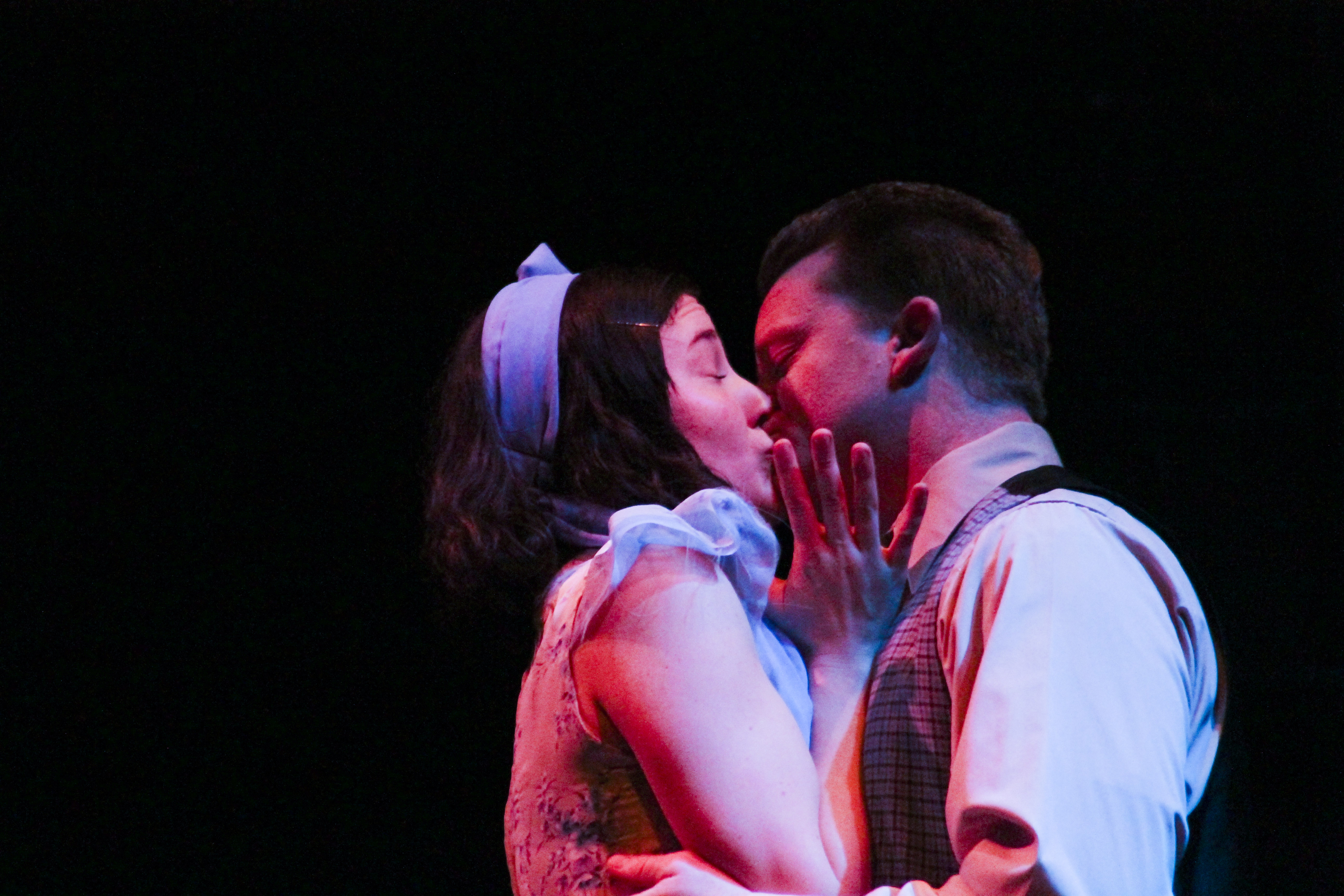 Jim O'Connor (right, performed by Ryan Balfour) surprises Laura (left, performed by Abby Fields) with a kiss in the dress rehearsal of The Glass Menagerie by Tennessee Williams playiing at Palomar College. Lucas Spenser/Telescope.
