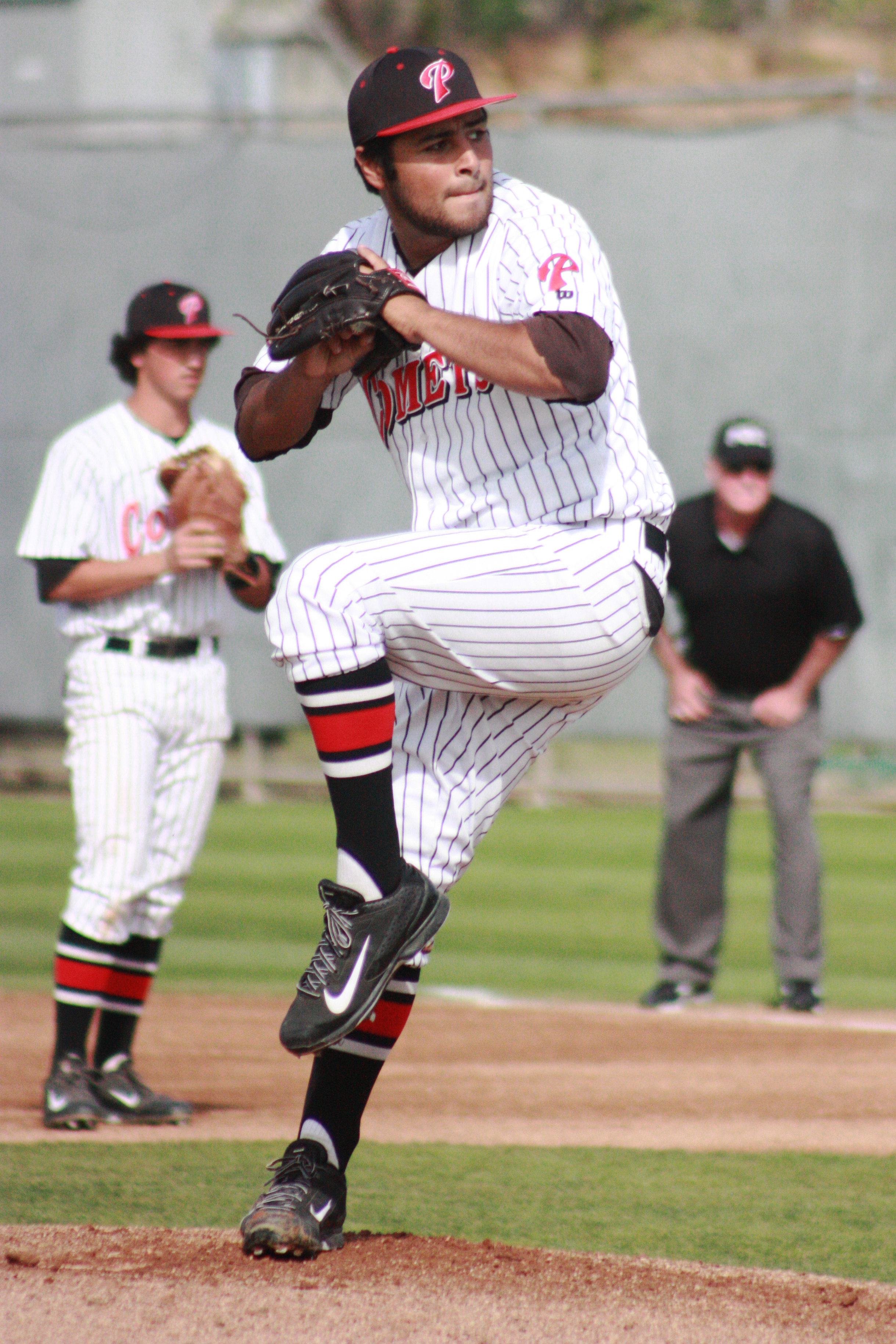 Starting pitcher Emilio Esquibel (#9) throws a pitch to his opponent from College of the Desert on Feb. 20 at Myers Field. Esquibel earned his first win of the season, throwing 6 1/3rd shutout innings while striking out 4 and walking none in the Comets' 5-0 win over the Road Runners. Scott Colson/The Telescope