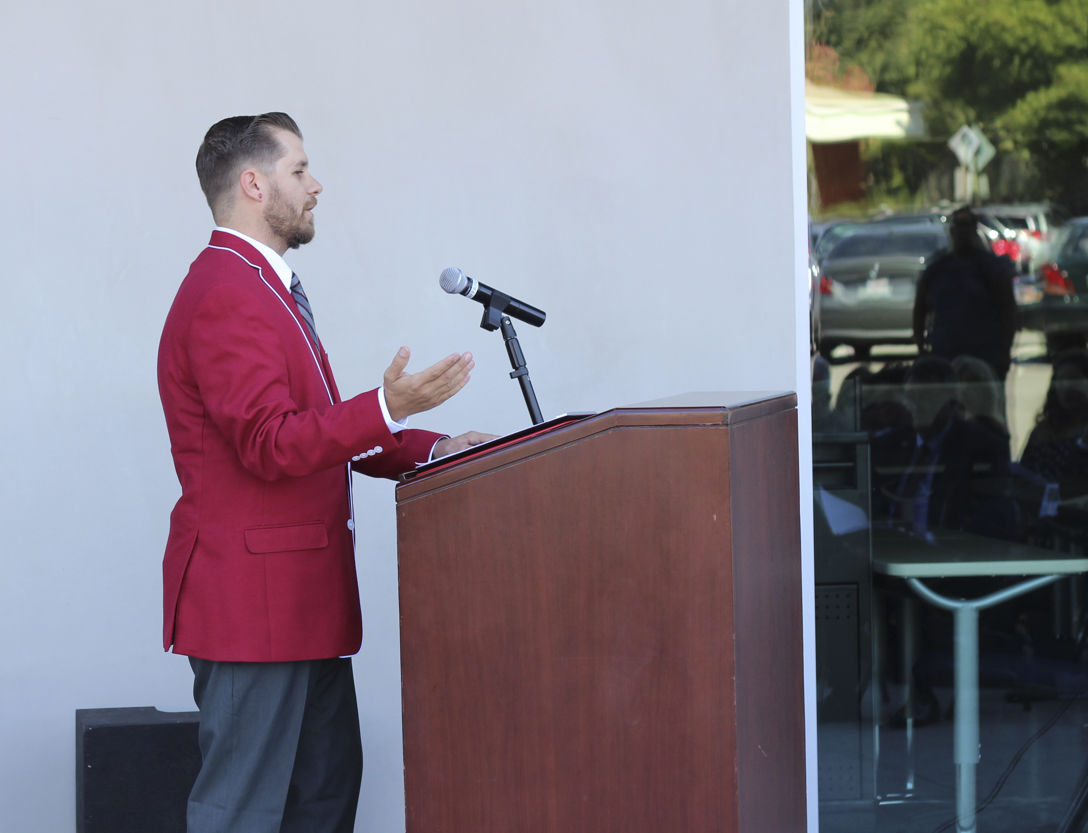 Associated Student Government President Jason Hosfield speaks at the Humanities Open House ceremony Oct. 10 outside the new building. Photo courtesy of Deb Hellman