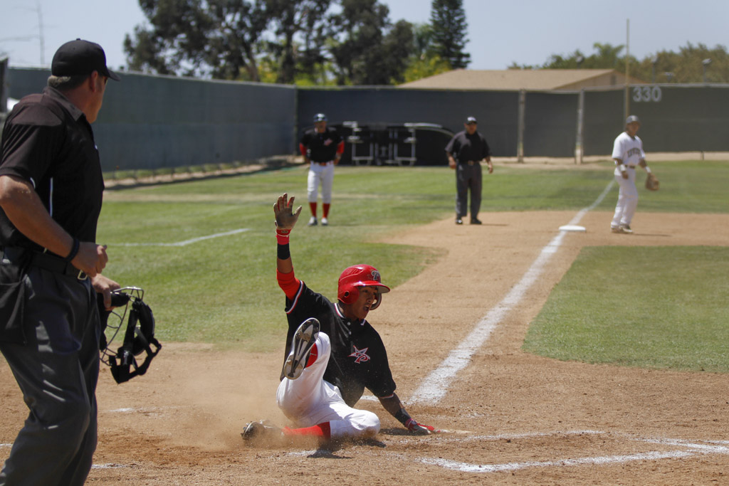 Palomar's Alec Salcedo scores the first run of a three run third against visiting Irvine Valley College 10 May at Myers Field. The Comets won the game 11-1 and swept the Lasers 2-0 in the Super Regional. Philip Farry / The Telescope