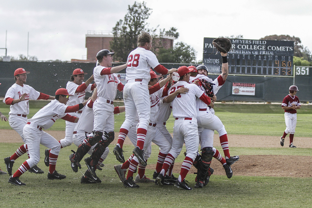 Palomar's players celebrate after the final out is recorded in the bottom of the eleventh inning against visiting Saddleback College at Myers Field May 17. The Comets won 4-3 in 11 innings to sweep visiting Gauchos and advance to the final four to be held in Fresno next weekend. Philip Farry / The Telescope