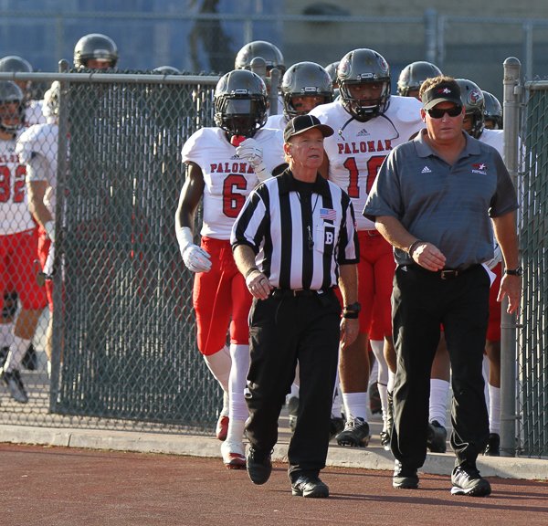 Palomar head coach Joe Early leads the Comets onto the field prior to the start of the game. Palomar opened their season Sep 5 on the road in Glendora California against Citrus College. The Comets beat the Owls 24-14. Philip Farry / The Telescope