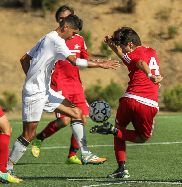 Palomar's Ivan Curiel (4) keeps control of the ball during the second half. The Comets beat the Knights 3-1 at Minkoff Field Oct 13. Philip Farry / The Telescope
