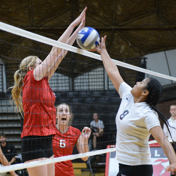 Palomar's Taylor Schade (#18) blocks a shot during the second set against Mt. San Jacinto on Friday, Nov. 6, 2015 at the Dome. Palomar defeated Mt. San Jacinto three sets to one (25-14, 25-23, 22-25, 25-29). Yvette Monteleone / The Telescope 2015