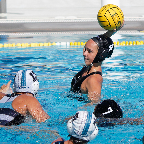 Palomar's Carly Woods (4) throws goal 10 for the Comets at the 2015 Women's Water Polo Pacific Coast Athletic Conference on Nov. 7 at the Ned Baumer pool. Miramar's Ana Walker (13) attempts to defend while Dallas Fatseas (7), Lauren Wimsatt (10) and Makana Edwards (5) look on. The Pacific Coast Athletic Conference (PCAC) is an intercollegiate athletic conference governed by the California Community College Athletic Association (CCCAA). Palomar defeated Miramar 14 - 6. The Comets took third place overall. Coleen Burnham/The Telescope
