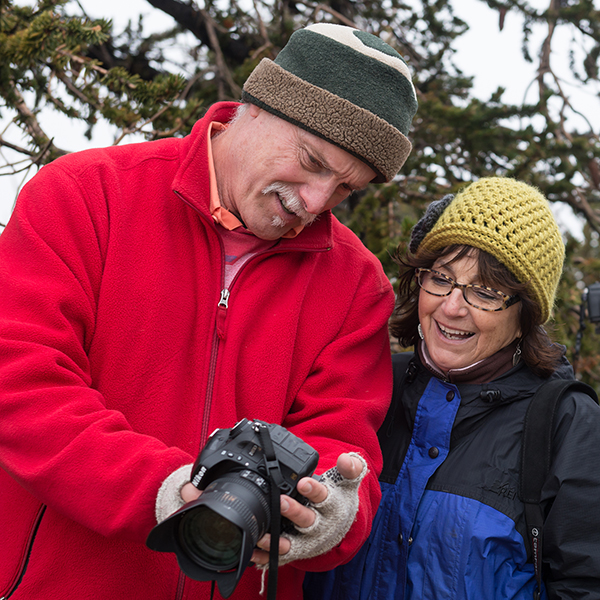 Palomar professor, Donna Cosentino (center), views images from the back of student, Grant Thompson's (left), camera while fellow student, Niko Holt (right), looks on. The Ancient Bristlecone Pine Forest in Schulman Grove is one of the classes many stopping points during the Landscape and Culture Class 5 day field trip lead by Cosentino, Oct. 16, 2015. Brandy Sebastian/The Telescope