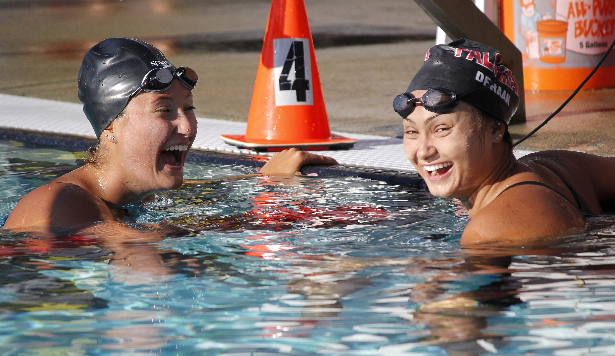 Palomar's Michelle Jacob (L) and Paulina DeHaan (R) are all smiles after swimming the Women's 100 Yard Backstroke championship final during the 2016 PCAC Swim Meet on April 22 at the Wallace Memorial Pool. Jacob placed first with a time of 1.01.68 and DeHaan placed second with a time of 1.04.30. Coleen Burnham/The Telescope