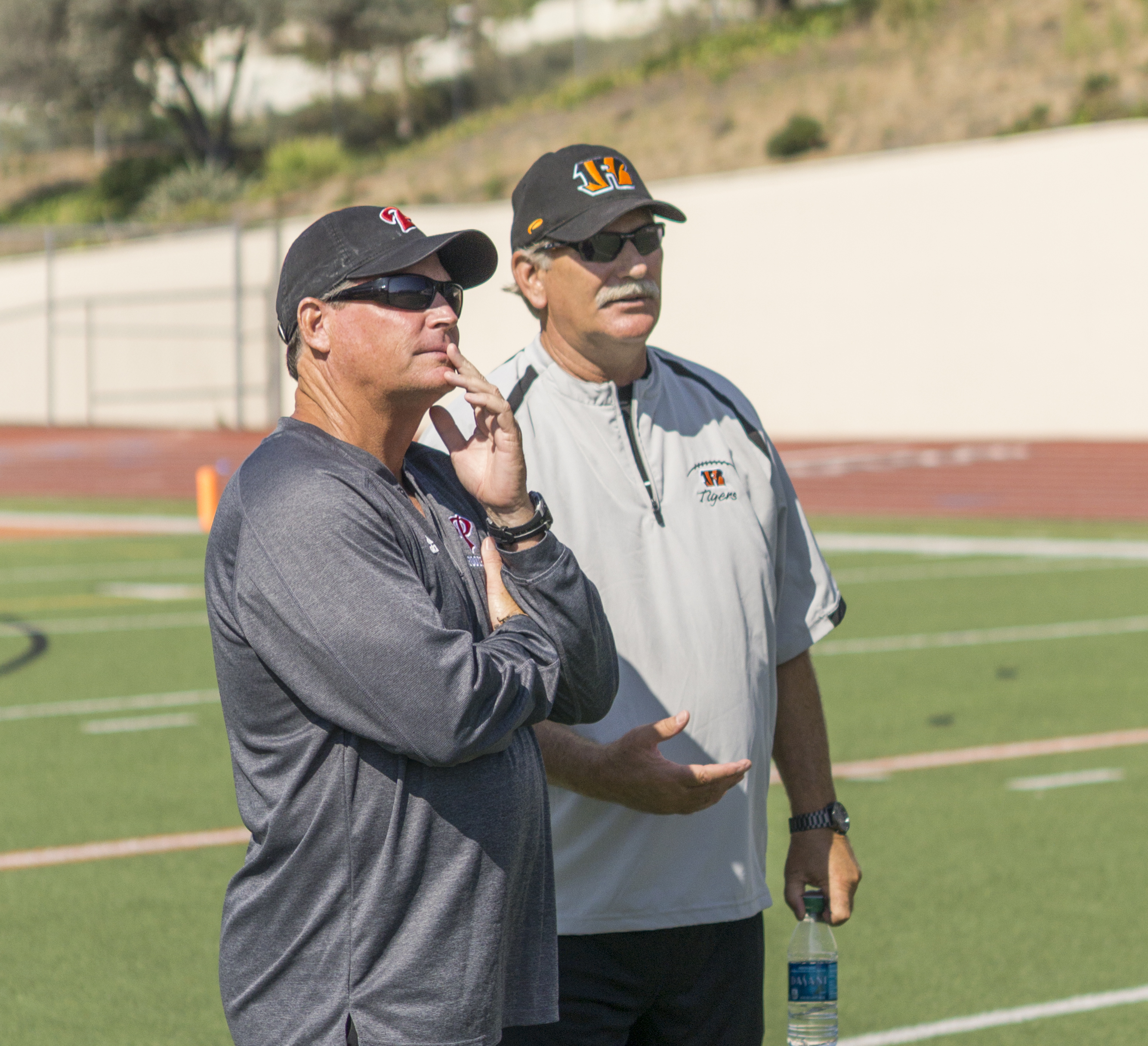 Palomar coach Joe Early (left) and Riverside City College coach Tom Craft (right) (Craft was head coach of the Comets from 1983-2000) watch as their teams go through warm-ups prior to the scrimmage. The Comets hosted the visiting Tigers in a scrimmage held Aug 27 at Wilson Stadium in Escondido High School. The Comets open the season at home on Sept 3 at 6pm in a non-conference game against Southwestern.