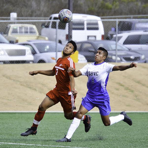 Palomar midfielder Elijah Lopez (7) and San Bernardino Valley College forward Jakob Salinas (6) fight for possession of an airborn ball. Sept. 27 on Minkoff Field. Dylan Halstead/The Telescope