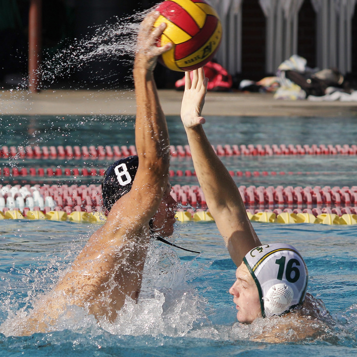 Palomar's Grant Curry (8) wrestles for the ball with Grossmont's Conner Keils (16) during the Men's Water Polo PCAC Conference Championship Game between Palomar and Grossmont on Nov. 5 at the Ned Baumer Pool. Palomar men won the title with a score of 10-9. Coleen Burnham/The Telescope