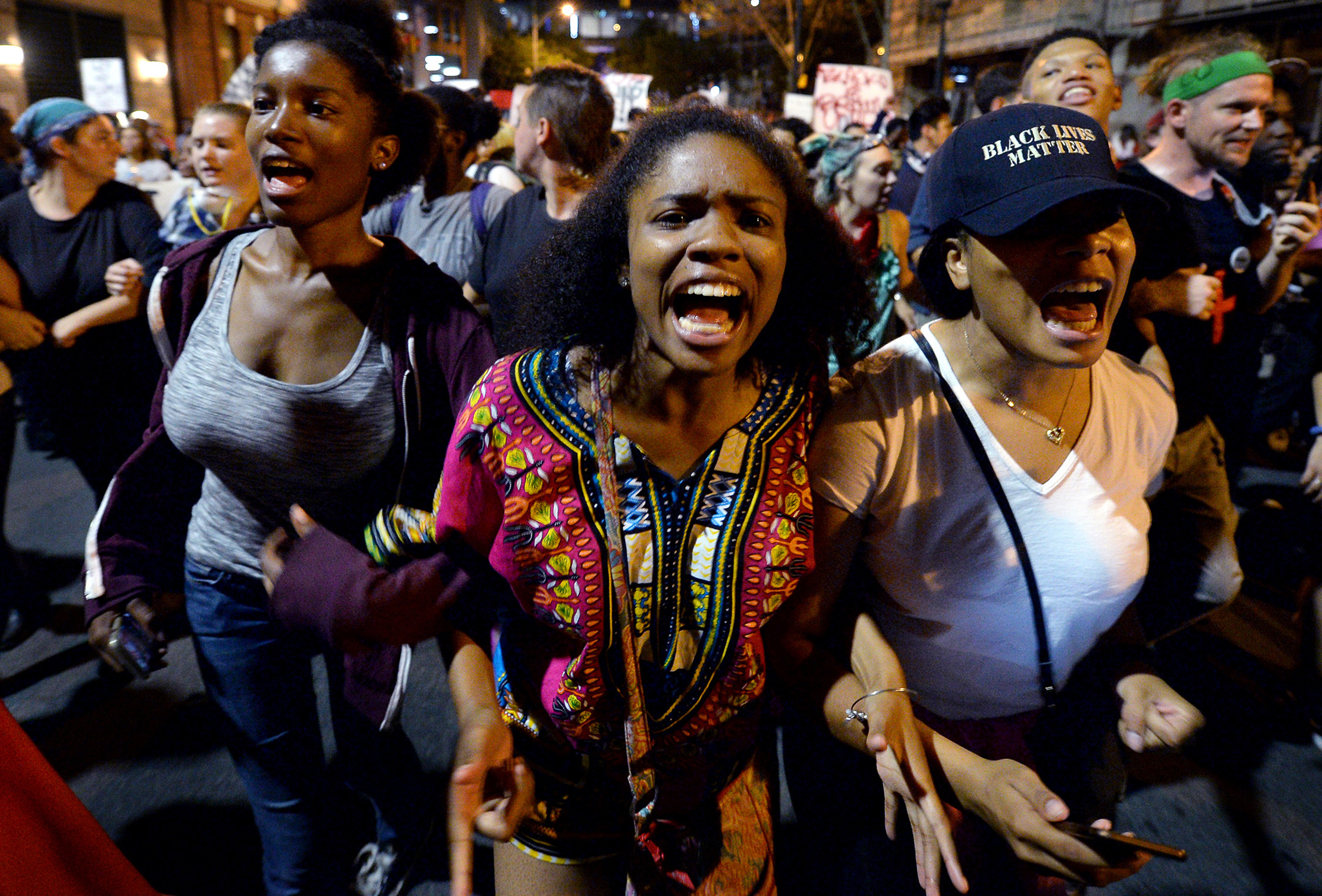"Protesters chant ""Black Lives Matter"" as they march throughout the city of Charlotte, N.C., on Friday, Sept. 23, 2016, Demonstrations continue following the shooting death of Keith Scott by police earlier in the week. Jeff Siner/Charlotte Observer/TNS"