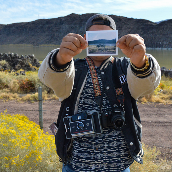 Photography student Irwin Sanchez holding one of his polaroids. Oct. 11. Brianna Dice/The Telescope