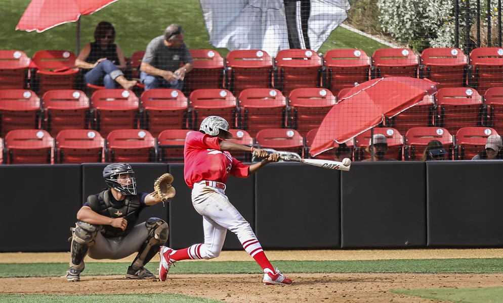 Palomar's Eric Charles hits a line drive to right field during the fifth inning against the visiting San Diego Padres Scout team Oct. 29. Philip Farry/The Telescope