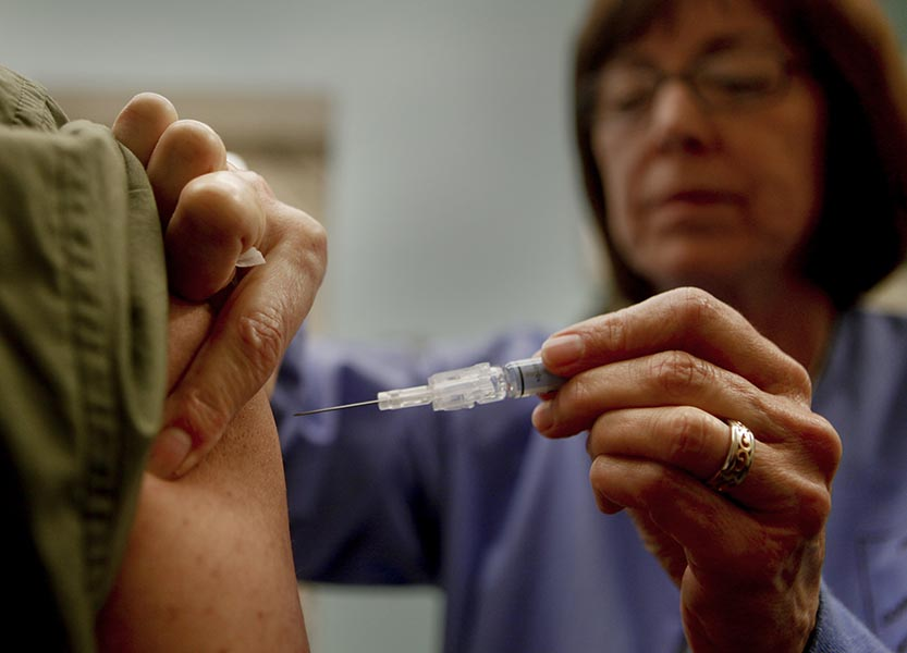 Downey Regional Medical Center RN Connie Meinke administers the flu vaccine to fellow employee Brian Virk on January 17, 2013. Like many hospitals across the U.S., the Downey, California, facility is preparing for the flu onslaught. The hospital is asking all of their employees to be vaccinated. (Mark Boster/Los Angeles Times/MCT)