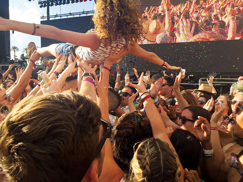 A woman crowd surfs amongst a crowd at a festival attendees at the 2016 Coachella Music Festival in Indio, Calif. Cristina Angel/The Telescope