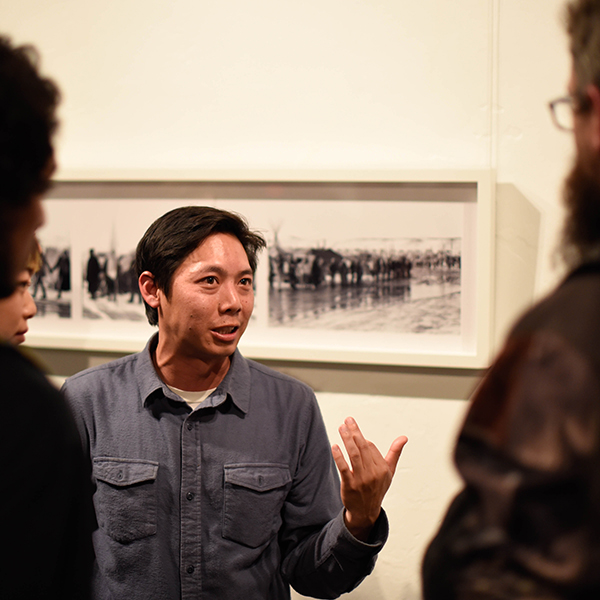 "Former Palomar College student Johnny Nguyen at his exhibit: ""And If I Can Show You, You Would Never Leave Her"" at the Hill Street Country Club in Oceanside on Feb 4. Christopher Jones/The Telescope"
