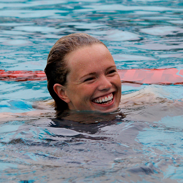 Palomar's Emma Thomas is all smiles as she waits to swim her first race on day two of the 2017 Waterman Festival at the Wallace Memorial pool on Feb. 11. Palomar women won the meet with a score of 602. Cerritos scored 429 points, Mesa scored 346 points and Chaffey scored 208. Coleen Burnham/The Telescope