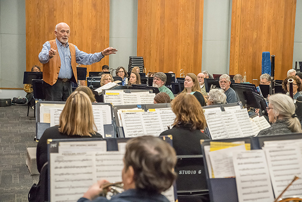 Kenneth Bell conducts the Palomar/Pacific Coast Concert Band during a rehearsal on Feb. 16, 2017 for their upcoming performance at Palomar College. Joe Dusel /The Telescope.