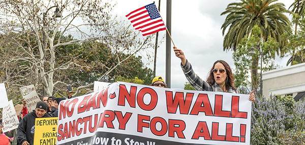 Protesters rallied and marched in Vista to voice their concerns over the recent actions by the Trump administration regarding banning travel from certain predominantly Muslim countries, and also the plans for mass deportations of undocumented immigrants from Mexico and elsewhere in South America on Feb. 18, 2017. Joe Dusel/The Telescope