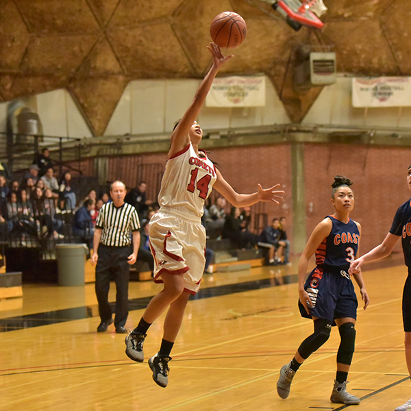 Palomar Guard Roshell Lamug (14), scored 7 points and grabbed 5 rebounds during the second round of the CCCAA State Tournament as the comets defeated Orange Coast Pirates 80 to 77 at the Dome Feb. 24. Lamug was also named the PCAC North Division's Women's Basketball Player of the Year. Johnny Jones/The Telescope