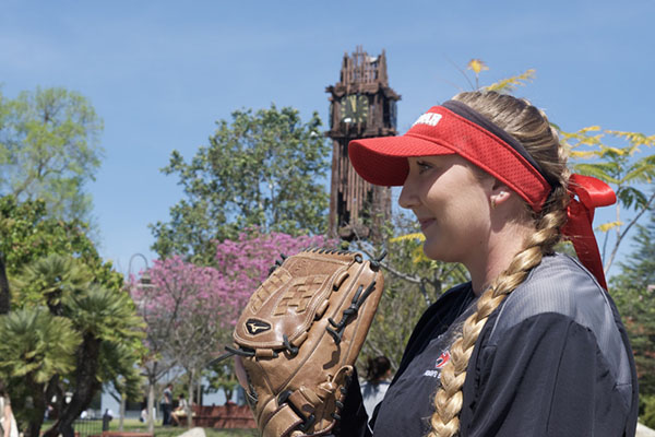 Crystal DesLauriers poses in front of the clock tower before leaving for an away game at San Diego City College on April 5. Jacob Tucker/The Telescope