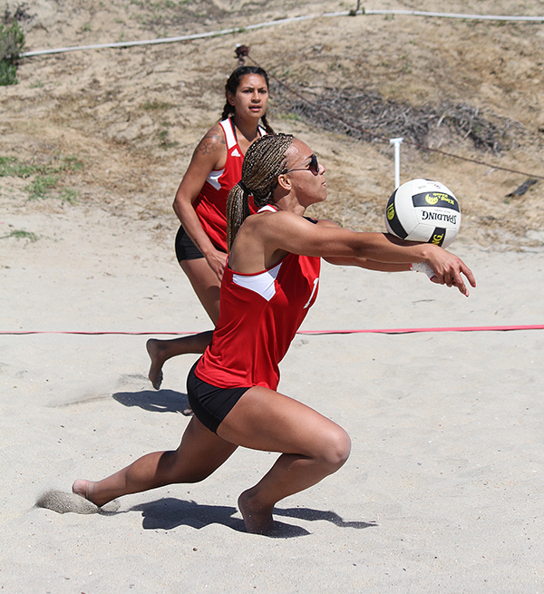 Palomar's Brittany Mitchell (front) gets ready to hit the ball during the Women's Beach Volleyball Tournament on March 24 at Frazee Beach as teammate Kianna Niu (back) looks on. Palomar, Mesa and Grossmont participated in the tournament. Coleen Burnham/The Telescope