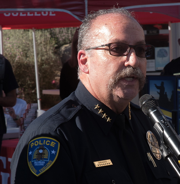 Palomar Police Chief DiMaggio sends a warm welcome to the surround law enforcement officer and students of Gear Up youth teen program to the first ever Public Safety Community outreach event to inspire leadership and community involvement on Palomar Campus, April 5. Johnny Jones/The Telescope