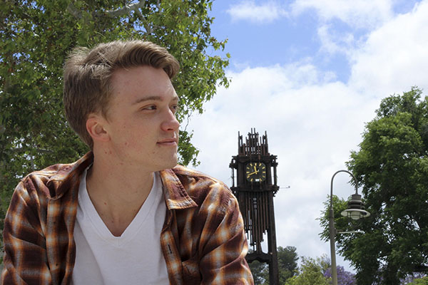 Jacob Tucker poses in front of the clocktower. Justin Gonzalez/The Telescope