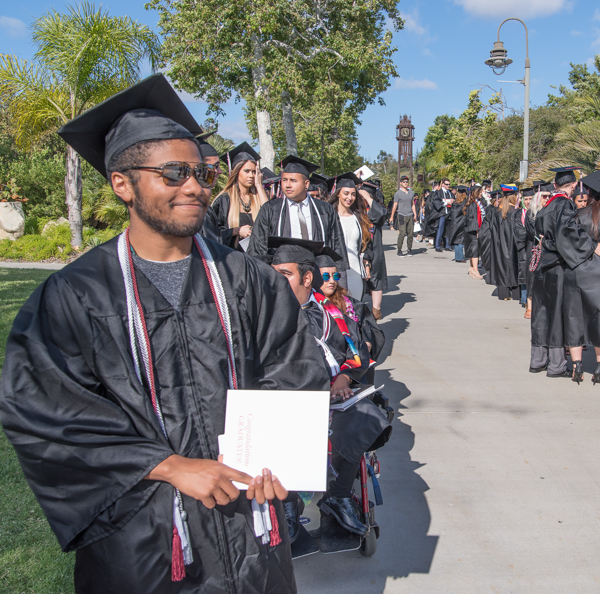 ASG President Malik Spence (left) at the front of the line of graduating students as they wait in line before the commencement ceremony at Palomar College in San Marcos, San Marcos, Calif. on May 26, 2017. Joe Dusel / The Telescope