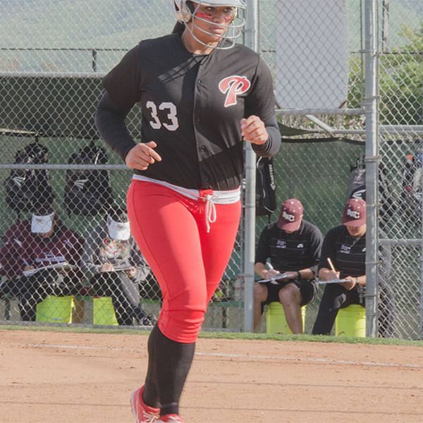 Palomar College Comets right field utility player, Tiare Paopao, returns to the dugout during the Comets game against the Southwestern College Jaguars on April 7, 2017 at Palomar College. The Comets beat the Jaguars 10-1 in six innings to remain undefeated in the Pacific Coast Athletic Conference. Kathleen Coogan/The Telescope