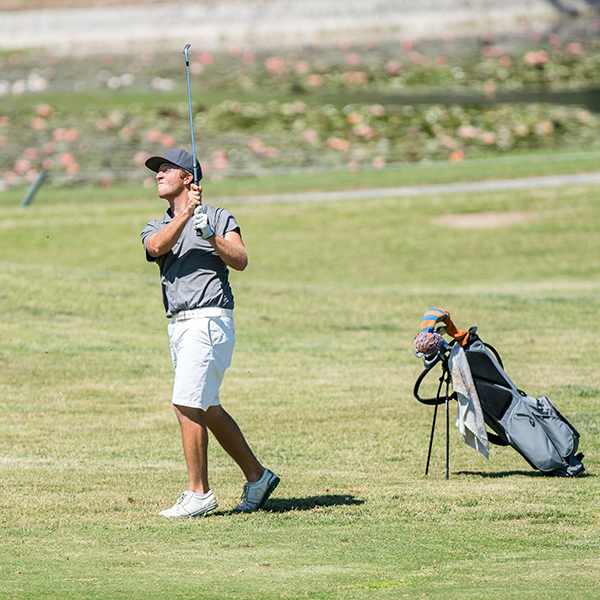 Palomar's Mitch Cannon hits an iron off the right rough of number 9 onto the green to leave himself a nice chance at birdie during Wednesday's match at Twin Oaks Golf Course. Pat RIndone / The Telescope