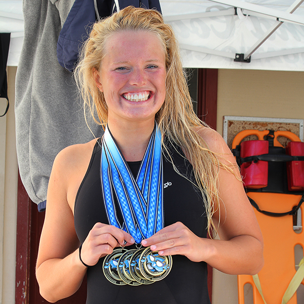Palomar's Emma Thomas poses with her medals after the completion of the PCAC Swim Conference Meet on April 22 at the Wallace Memorial Pool. Thomas won every personal event she swam, broke 2 records and was named Conference Women's Swimmer of the Year. Coleen Burnham / The Telescope
