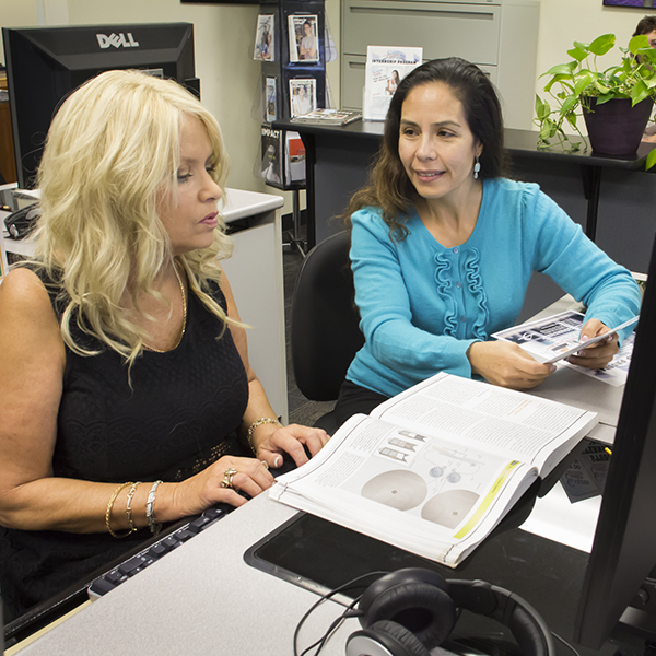 (Lto R) Student Connie Johnson gets help from Advisor Rosie Antonecchia about the Internship program at the Palomar College Career Center in San Marcos, Ca. 11-04-2015. Patty Hayton / The Telescope