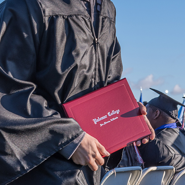 Happy and well educated graduating students proudly receive their diplomas at the commencement ceremony at Palomar College in San Marcos, Calif. on May 26, 2017. Joe Dusel / The Telescope.