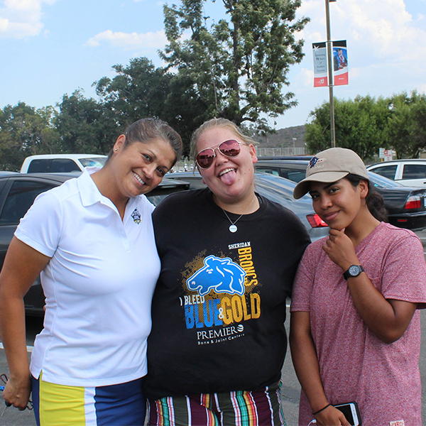 The women's golf team, left to right: Abby Corona, Victoria Owings, and Michelle Delacruz Luna, pose before heading off to the Desert Classic on Aug. 31. Justin Gonzalez/ The Telescope