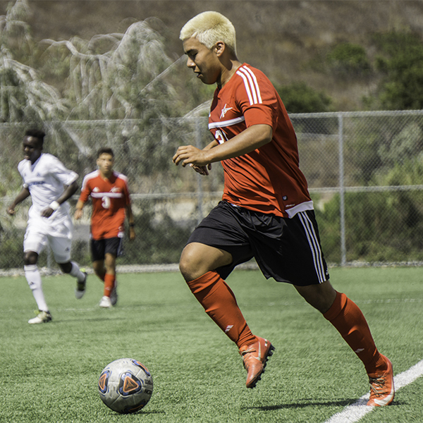 Palomar forward Ronny Rubio advances the ball forward during the game against Mira Costa on Sept. 22. at Minkoff Field. The final score was 2-1 in favor of Cuyamaca. Anthony Cole/ The Telescope